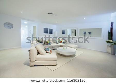 Modern living room with couch and round table in new Australian apartment #116302120