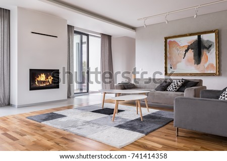 Modern living room with fireplace, sofa, balcony and pattern carpet