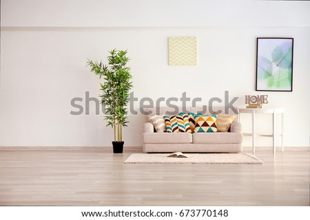 Modern living room with grey couch #673770148