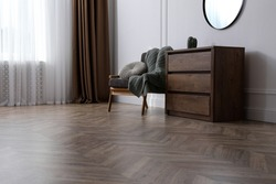 Modern living room with parquet flooring and stylish furniture