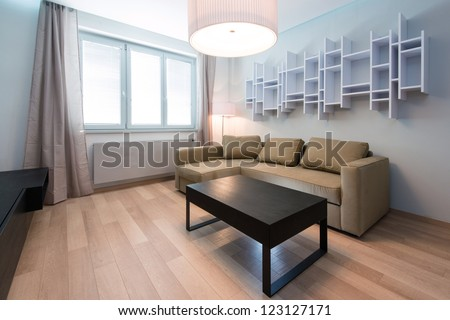 modern living-room with table and sofa