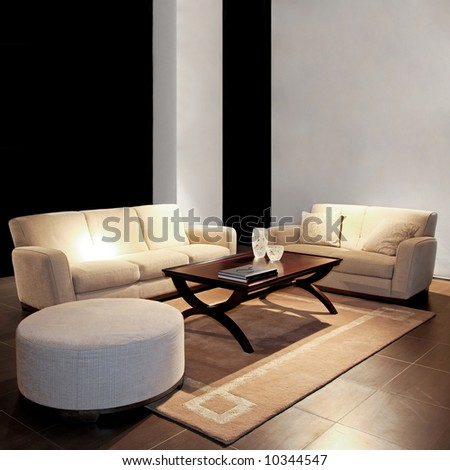 Modern living room with two beige sofas