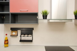 modern loft style kitchen with stove, fume hood and countertop.