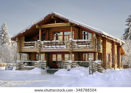 Modern log cabin, wooden vacation home, winter timber house with large windows, balcony and porch, snow-covered spruce forest. #348788504