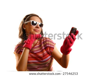 Modern looking young woman wearing sun glasses, looking at the phone