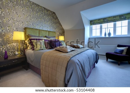 Modern luxurious bedroom dressed with opulent fabrics