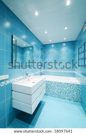 Modern luxury bathroom blue interior. No brandnames or copyright objects. - stock photo