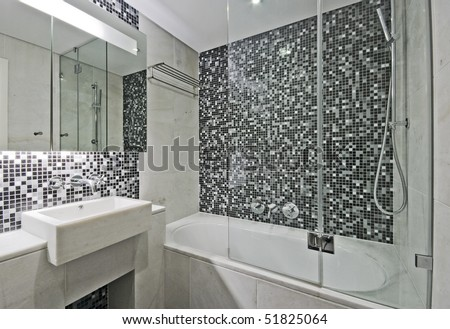 modern luxury bathroom with large bath tub and mosaic tiles - stock photo