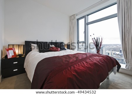 modern luxury bedroom in black and red