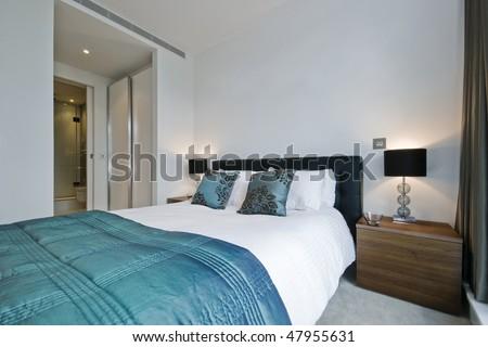 modern luxury bedroom with walk-in wardrobe and en-suite bathroom