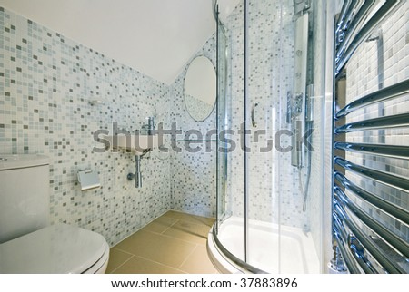 modern luxury en-suite bathroom with shower, wc wash basin and mosaic tiles