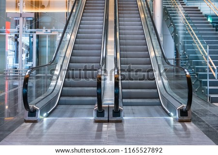 Modern luxury escalators with staircase at airport