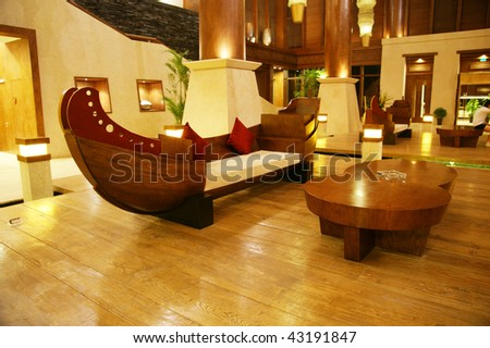 modern luxury hotel lobby with wood upholstering and furniture stock