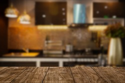 modern luxury kitchen black golden tone with wooden tabletop space for display or montage your products.