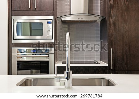 Modern luxury kitchen interior with stone countertop and stainless steel appliances #269761784