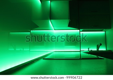 modern luxury kitchen with green led lighting
