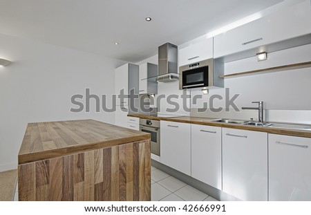 modern luxury kitchen with hard wood worktop - stock photo