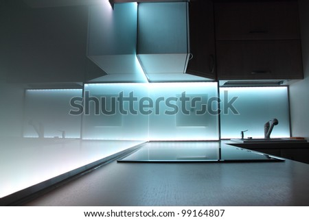 modern luxury kitchen with white led lighting - stock photo