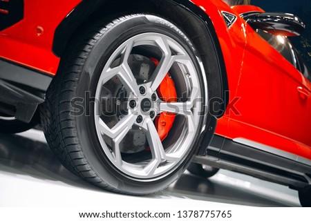Photo of Modern luxury suv car front wheel