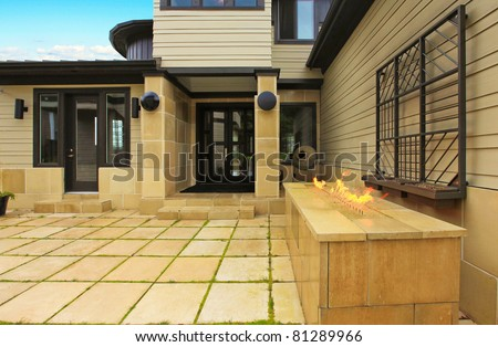 Modern luxury yellow stone large house. Waterfront. Fox Island. Washington State.