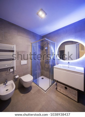 Modern marble bathroom with backlit mirror. Relaxing light. Nobody inside #1038938437