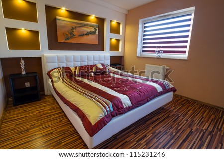 Modern master bedroom interior with picture of shipwreck on the wall (photo coming from my gallery)
