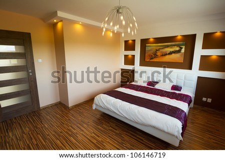 Modern master bedroom interior with picture of shipwreck. (photo of shipwreck coming from my gallery and is printed on canvas)