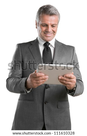 Modern mature businessman looking and working on digital tablet isolated on white background