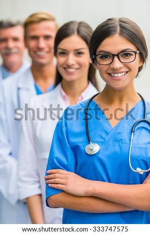 Modern medicine. Group successful doctors in hospital background