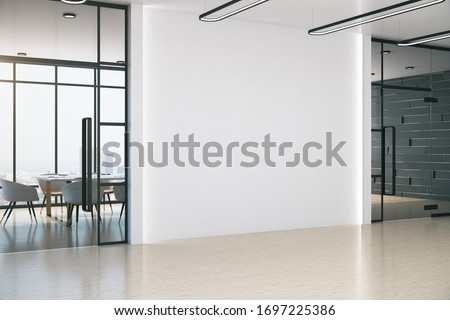 Modern meeting office with blank white wall, table and chairs. Workplace and lifestyle concept. 3D Rendering