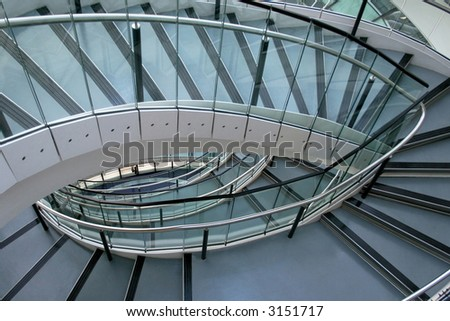 Modern metal and glass stairway in elliptical shape