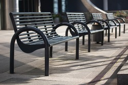 Modern metal benches in Vilnius city center, Lithuania. Empty city concept. Lockdown in the city.