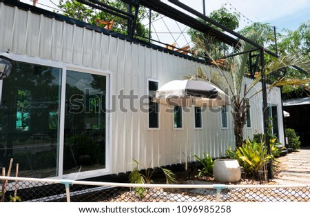 Modern metal building made from shipping house containers  #1096985258