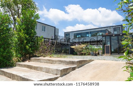 Modern metal building made from shipping house containers and blue sky background . #1176458938