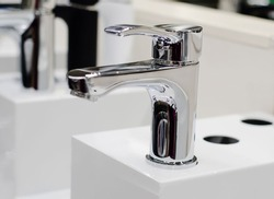 Modern metal mixer.  plumbing device that allows you to regulate  flow of water and get water of  required temperature when mixing hot and cold water.