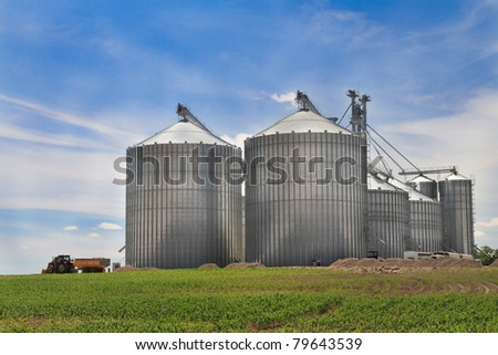 Modern metal silo with blue sky background