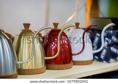 Modern metallic colorful teapots for filtered coffee, cafe shop #1079802041