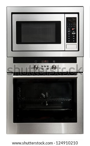 Modern metallic oven and microwave isolated on white