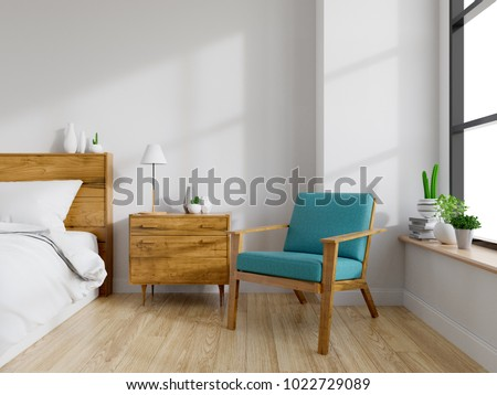 Modern mid Century and vintage interior of bedroom ,blue lounge chair with wood  bedside table and white bed  on white wall and wood floor in front of a window ,empty room ,3d rendering