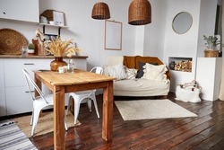 Modern minimal home interior in eco style. A natural bright apartment in trendly style. Decorative straw lamp.