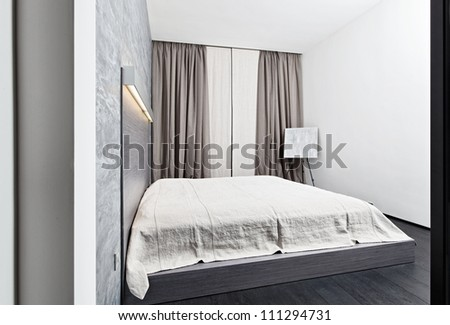 Modern minimalism style bedroom interior in monochrome tones