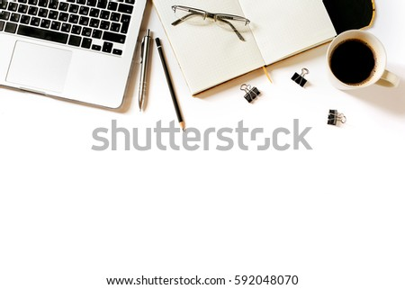 Modern minimalistic work place. White office desk table with laptop, coffee cup, clips, glasses, notebook, pen and pencil. Top view with copy space, flat lay #592048070