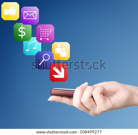 Modern mobile phone in hand and many social media symbols flying away