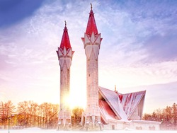 modern mosque in snow at winter landmark against scenic sunrise background. Wide view of muslim religion building in ufa city russia on new year eve. Winter wonderland on christmas time landscape