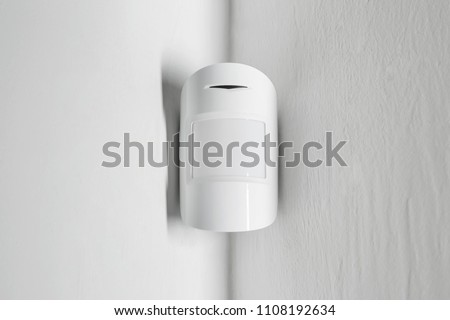 Modern motion sensor on wall indoors #1108192634