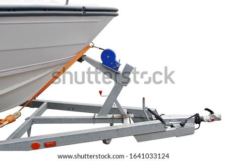 Modern motor boat on the trailer for transportation on white background stock photo