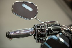 Modern motorcycle mirror and handlebar commands for cruise control, horn and lights