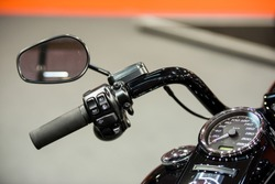 Modern motorcycle speedometer on dashboard and handlebar commands for cruise control, horn and lights