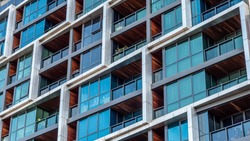 Modern multi-dwelling buildings, balconies close up. Family apartments in a strata living scheme of common property.