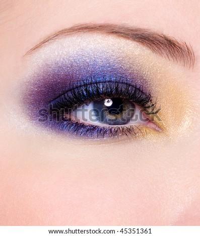 Modern Multicolored fashion makeup of a female eye - macro shot - stock photo